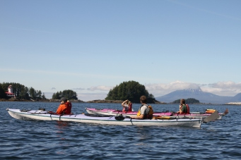 Nick (far right in green shirt) floats in kayak with SAIL participants